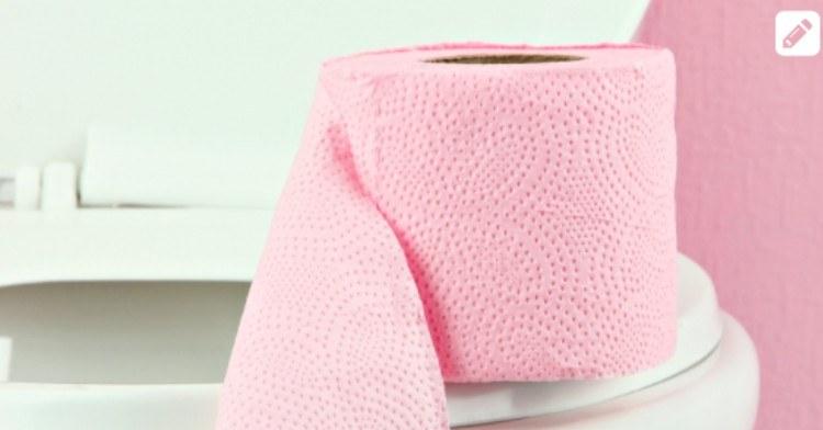 Pink Toilet Paper on White Toilet