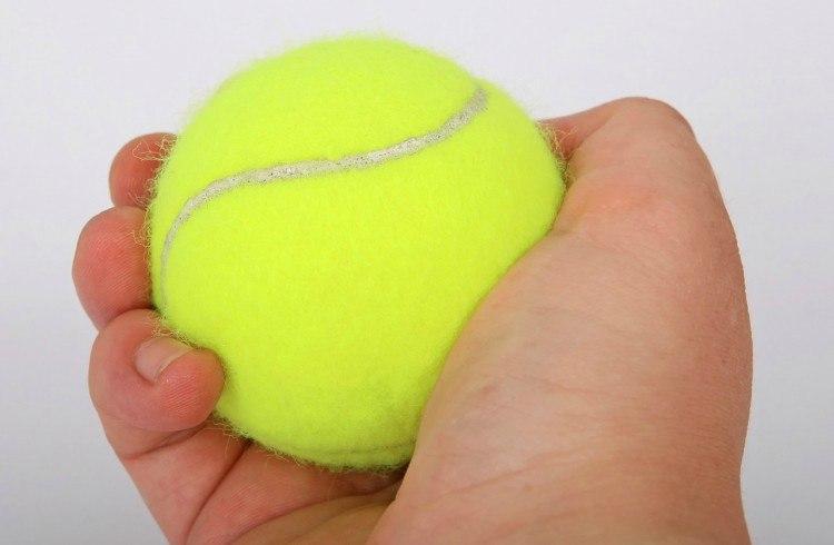 tennis ball hand