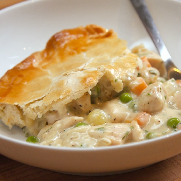 Serving of chicken pot pie in white bowl