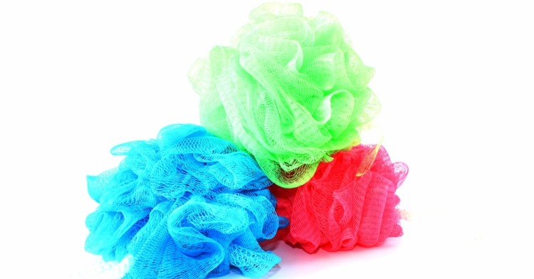 Stack of colored loofahs.