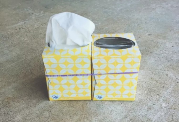 Two tissue boxes tied together.