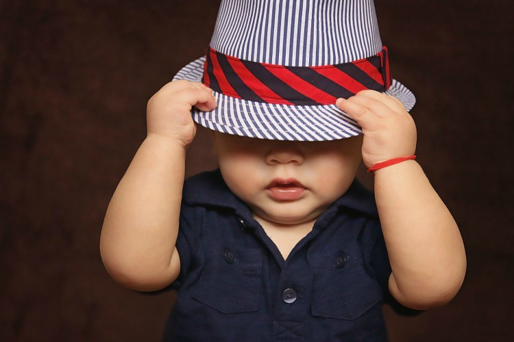 Image of baby boy in hat.