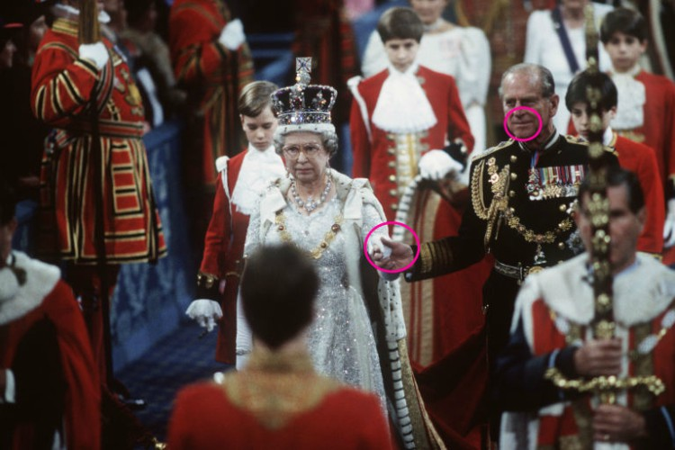 Image of Prince Philip and Queen Elizabeth holding hands at royal event.