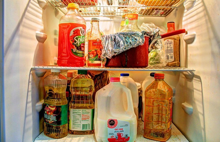 fridge filled with various food items