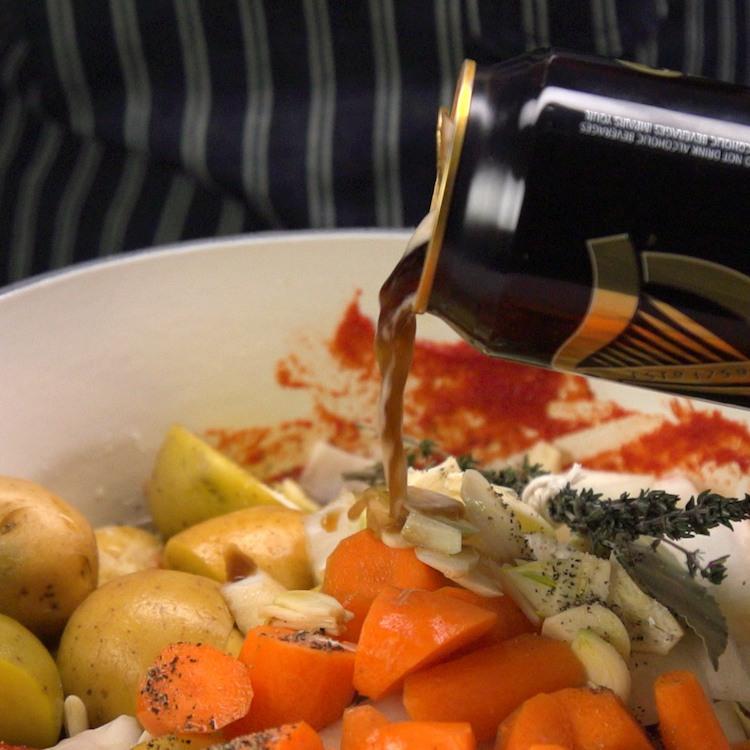 guinness beef stew ingredients in pot