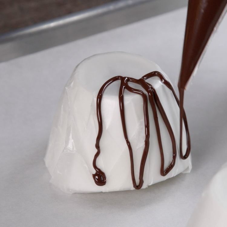 Squeeze chocolate over the lined bowls in a loopy,overlapping pattern