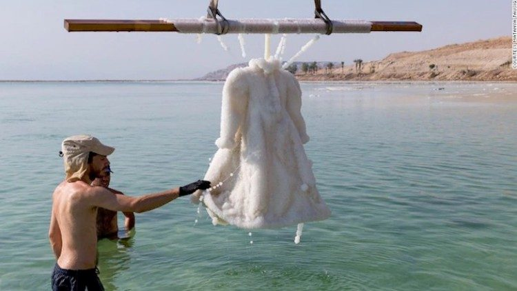 Artist left a wedding dress in the Dead Sea for two years.