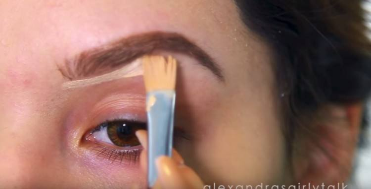 Applying eye shadow.