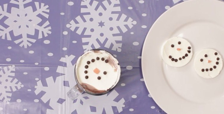 Finished whipped cream snowman toppings.