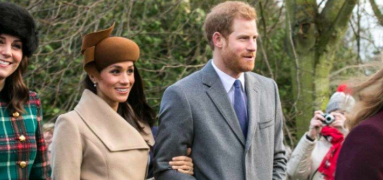 Meghan Markle and Prince Harry pose for photos