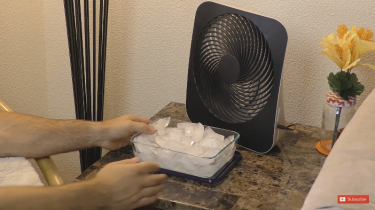 Put ice cubes in front of fan to cool off