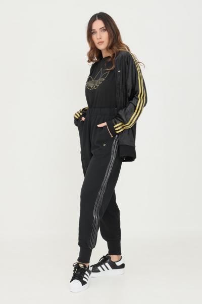 ADIDAS Pantaloni cuffed pants with velvet stripes and trefoil rivet donna nero adidas  Pantaloni | H18036.