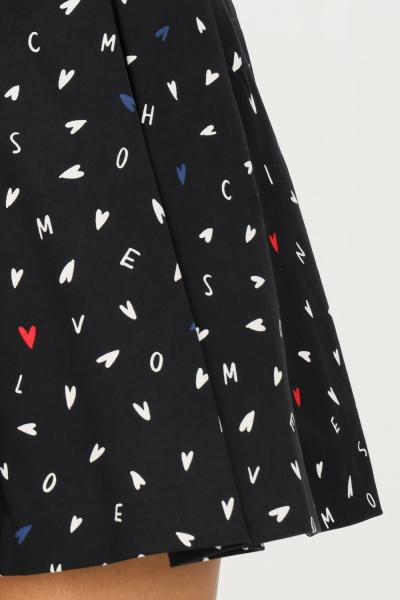 LOVE MOSCHINO Gonna corta nero love moschino con stampa logo e cuori allover  Gonne | WGE9700S37086024