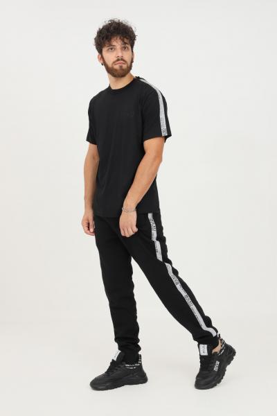 VERSACE JEANS COUTURE Pantaloni uomo nero versace jeans couture modello casual con bande laterali logate  Pantaloni   71GAA3B7F0002899