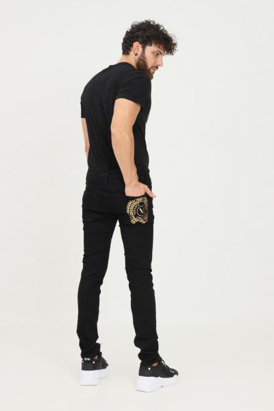 VERSACE JEANS COUTURE Pantaloni uomo nero versace jeans couture modello casual con stampa oro sul retro  Pantaloni   71GAB5K1CDW00909