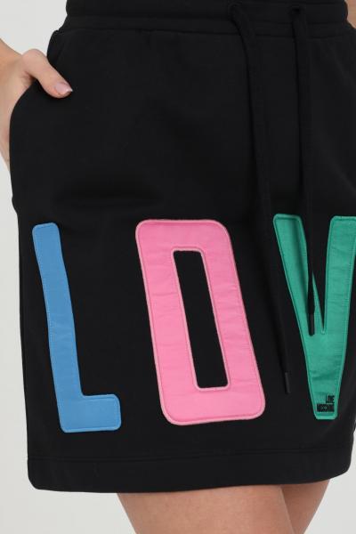 LOVE MOSCHINO Gonna donna nero love moschino corta con molla in vita e maxi logo lettering multicolor. Chiusura con lacci. Modello comodo  Gonne | W155881M4266C74