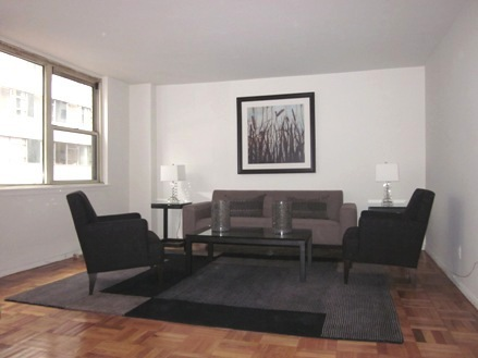 LIVE IN THE MIDDLE OF IT ALL-SOUGHT AFTER EXPANSIVE ONE CONVERTIBLE TWO BEDROOM CONDO