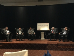 Panelists speak at the TCA breakfast