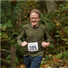 A happy trail runner at Carkeek Park