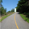 Short paved section under the blazing sun with steep grade