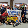 post-race runners with banner