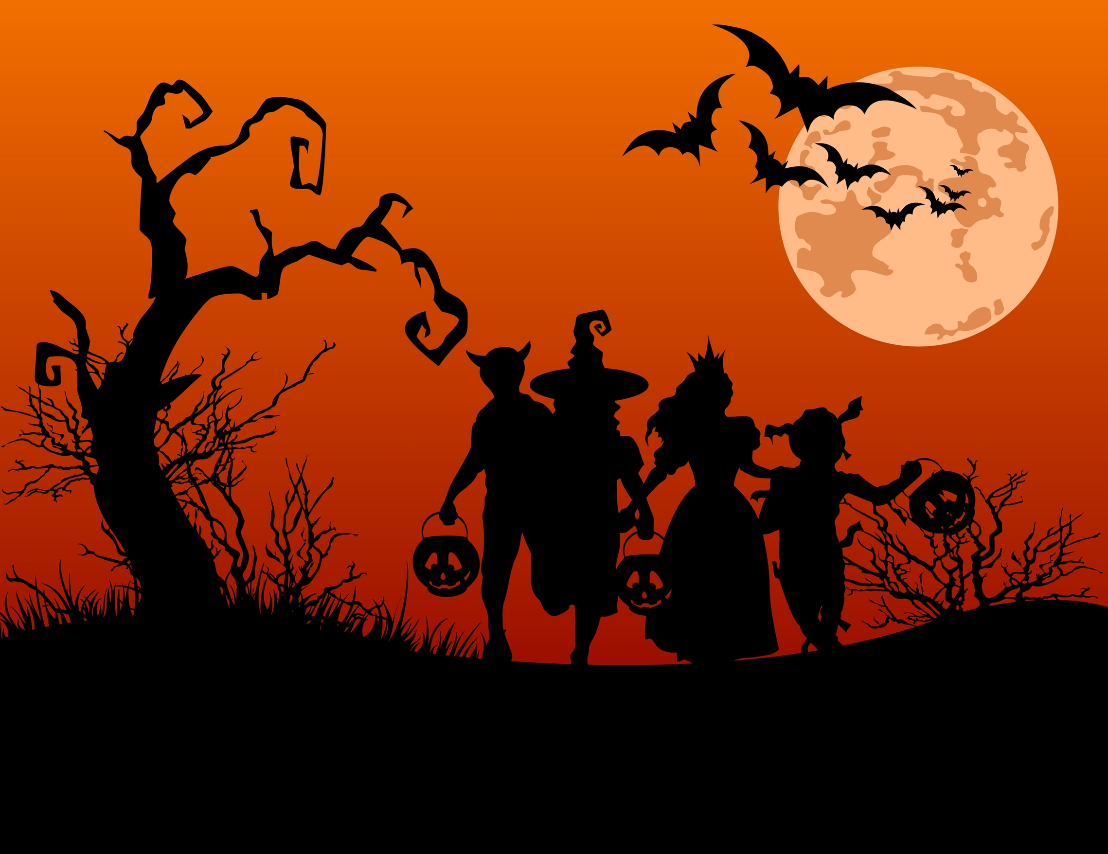 image of costumed people and craggy tree in black against orange sky