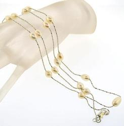 Collectible long pearl station necklace