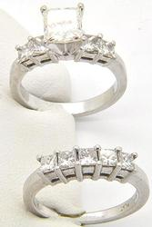 LADIES ENGAGEMENT RING WITH MATCHING BAND.