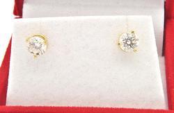LADIES 14KT YELLOW GOLD LADIES DIAMOND STUDS.