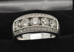 LADIES 14KT WHITE GOLD DIAMOND BAND.