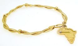 Cute 14kt Yellow Gold Charm Bracelet