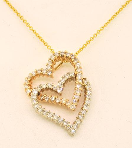 14kt gold double heart diamond pendant usauctiononline 14kt gold double heart diamond pendant mozeypictures Choice Image