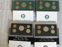 Four Proof Sets  1997 and 1978 One each clad and silver