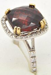LADIES 14 KT WHITE GOLD DIAMOND AND GARNET RING.