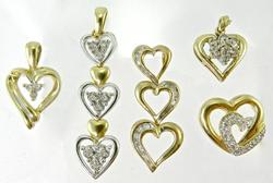 Group of 5 10k and diamond heart pendants