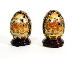 Two Oriental Porcelain Eggs Depicting Geishas Scenes