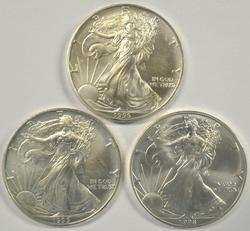 2 1995 and 1998 $1 Silver Eagles in Gem BU condition