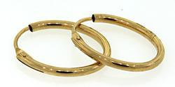 The Sleek Elegance of 18K Gold Oval Hoop Earrings