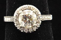 LADIES 18 KT WHITE GOLD DIAMOND ENGAGEMENT RING.