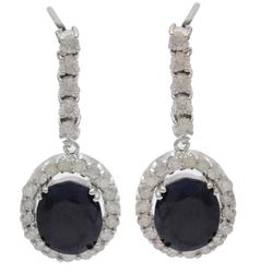A resplendent 5.78 ctw. Sapphire & Diamond Earrings