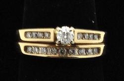 LADIES 14 KT YELLOW GOLD AND DIAMONDS WEDDING SET.