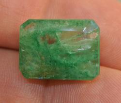 Highly unique bi-color 12.18ct Zambian Emerald