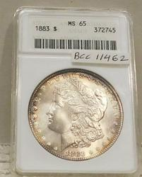 1883 Morgan Dollar ANACS MS-65, white satin, rim tone
