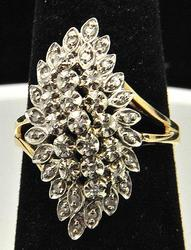 LADIES 10 KT DIAMOND CLUSTER COCKTAIL RING.