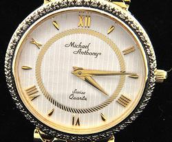 MEN'S MICHAEL ANTHONY 14 KT GOLD AND DIAMOND WATCH.