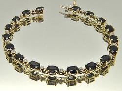 LADIES 10 KT YELLOW GOLD SAPPHIRE AND DIAMOND BRACELET.