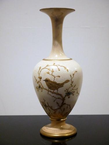 Vintage ceramic vase with gold details with bird motif