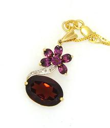 Exquisite Garnet Pendant with Diamond Accents on Gold Chain