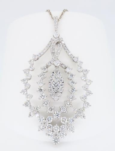 Diamond encrusted necklace in 14k and 18k white gold