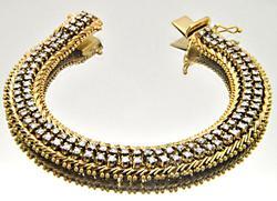 LADIES 14 KT YELLOW GOLD DIAMOND BRACELET.